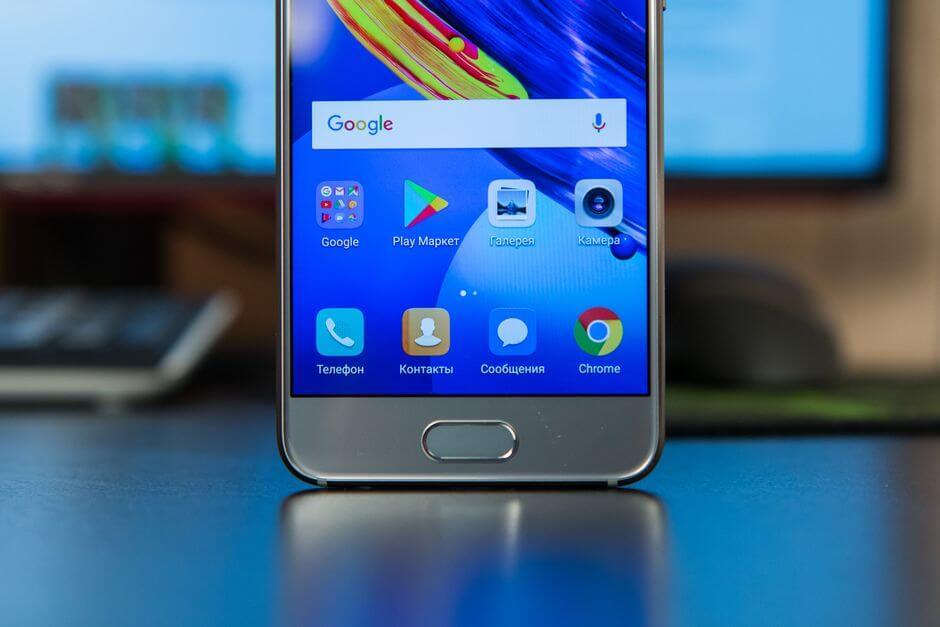 кнопки с сканер отпечатков пальцев в Huawei Honor 9